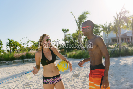 two young adult friends with beach