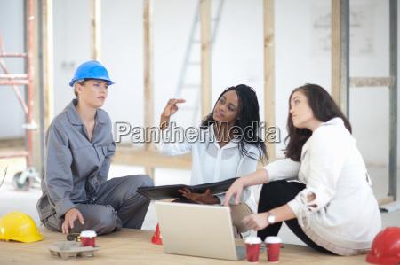 designers and laborer taking break on