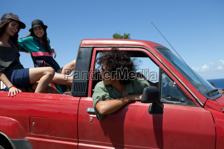 three young friends driving off road