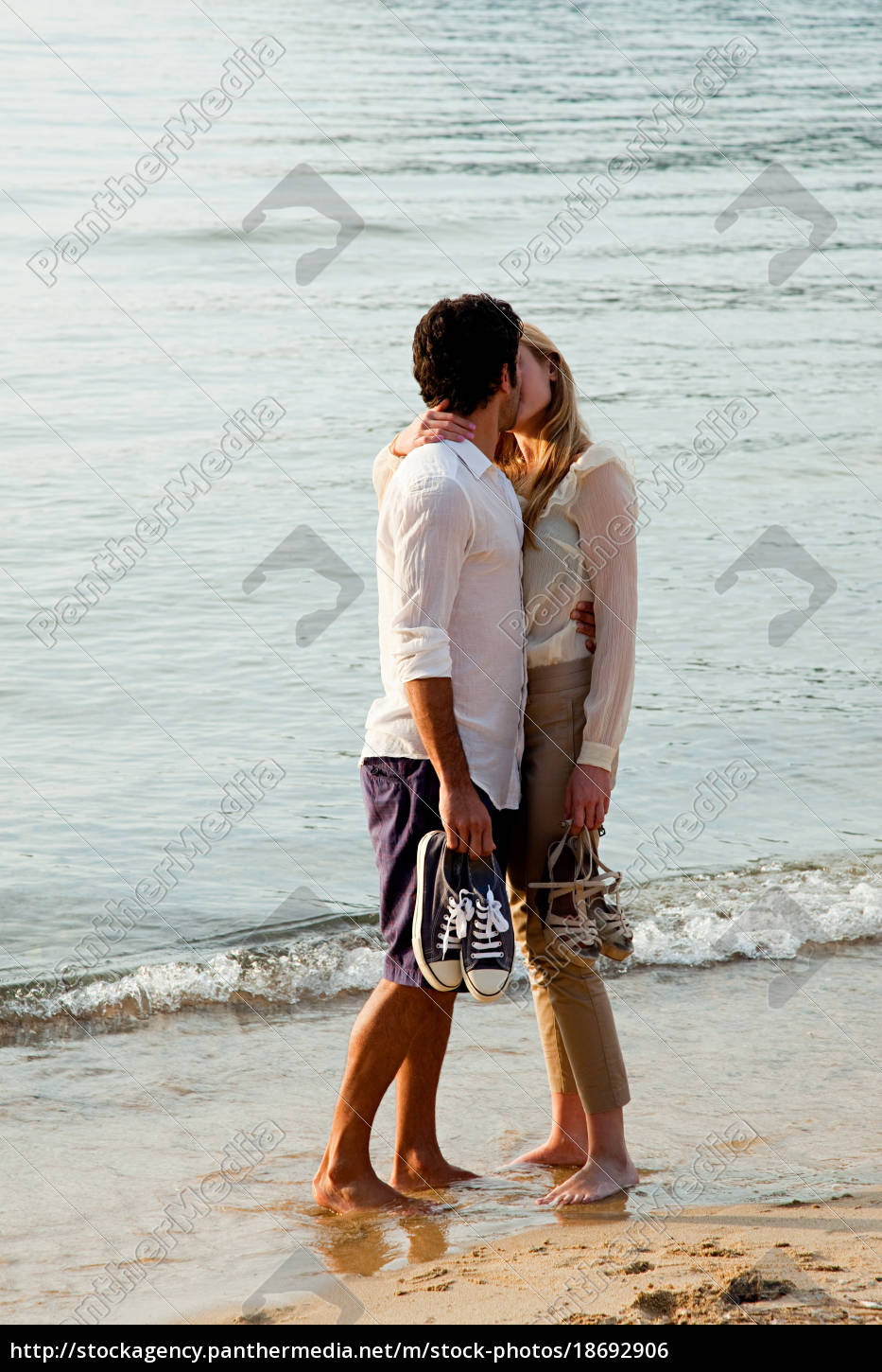 young, couple, kissing, on, beach - 18692906