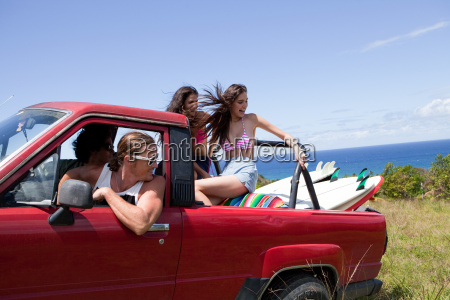 four young friends driving off road