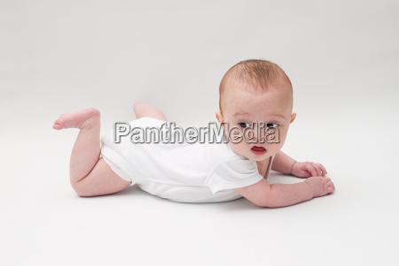 portrait of a baby boy lying