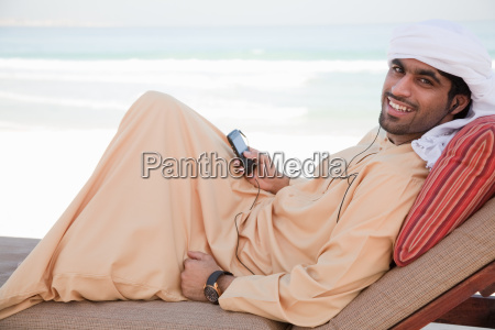middle eastern man with mobile phone