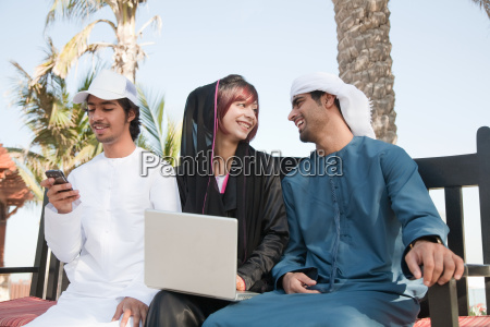 middle eastern people using laptop