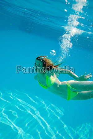 young, woman, swimming, underwater, in, swimming - 18693934