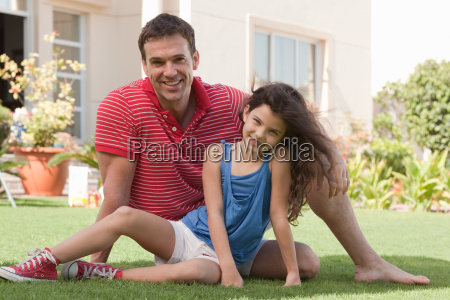 father and daughter in the garden