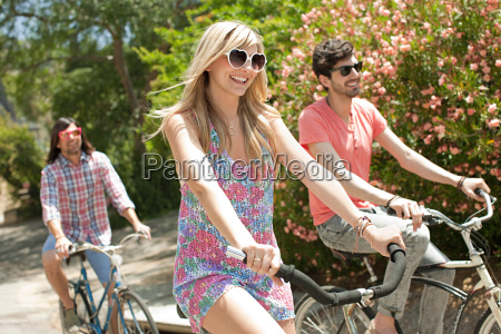 young friends cycling on vacation