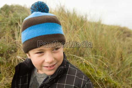 boy wearing bobble hat