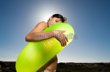 young, woman, wearing, inflatable, ring - 18698916