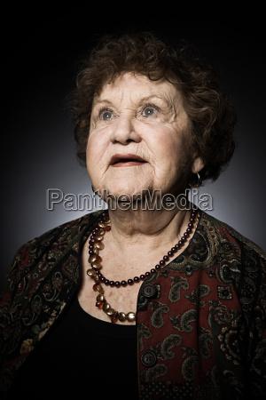 studio portrait of senior woman looking