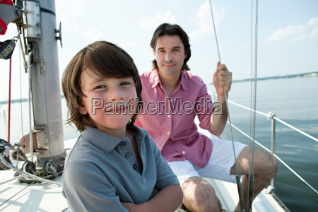 father and son on board yacht