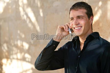 man in a black shirt using