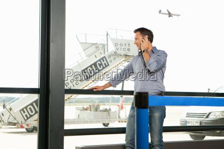 mid adult man on the phone