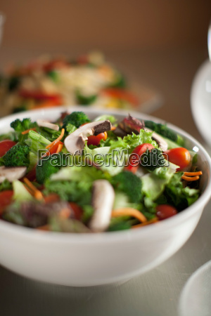 bowl of chopped salad on table