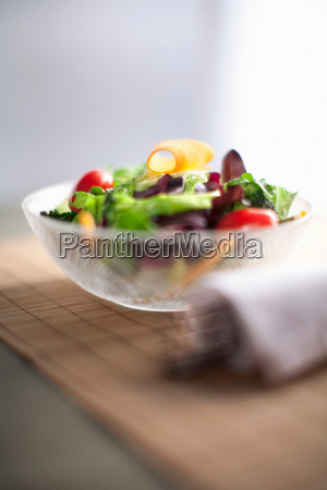 bowl of salad on wooden board