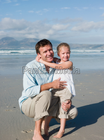 father and daughter at the seaside