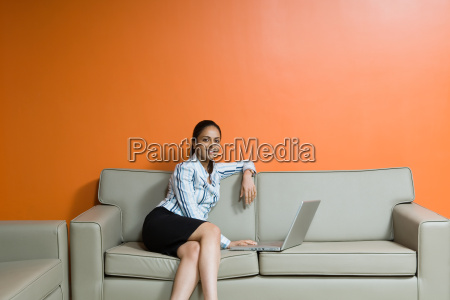 indian woman using a laptop computer