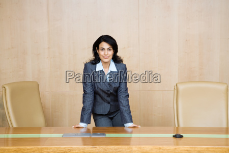 indian businesswoman in a conference room