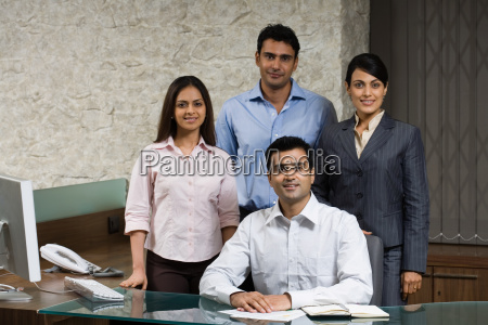 four indian office colleagues