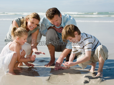 family, looking, in, sand - 18706426
