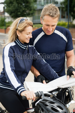couple of cyclists looking at a