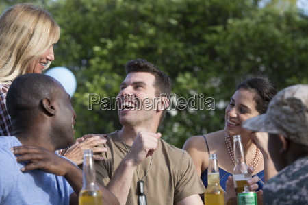 male soldier celebrating with family and