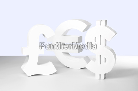 dollar euro and pound signs on