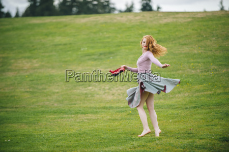 portrait of young woman dancing in
