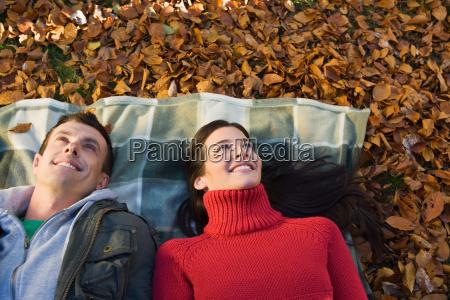 couple lying on leaves