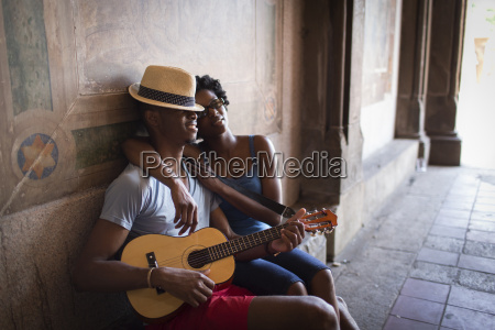 young couple sitting with mandolin in