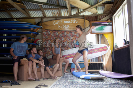 five young adult surfer friends fooling