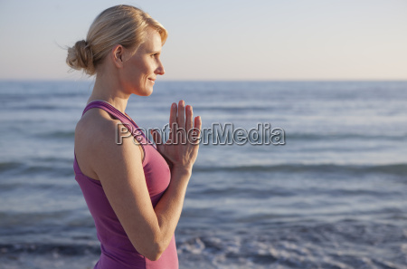 woman in yoga prayer pose on