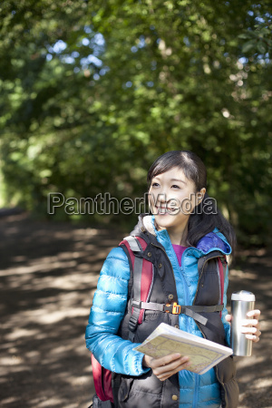 young female hiker with map and