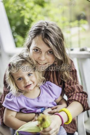 teenage girl and baby girl smiling