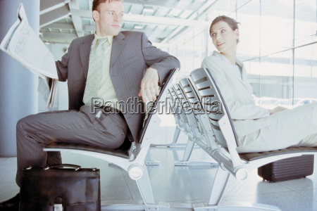 businessman and businesswoman meeting in airport