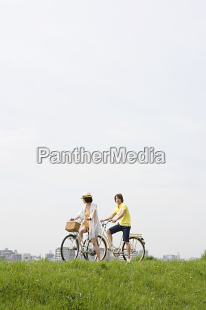 young couple cycling