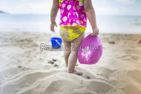 baby playing on sandy beach