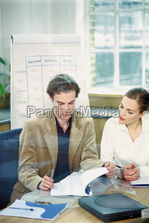 businessman, and, businesswoman, in, office - 18731980