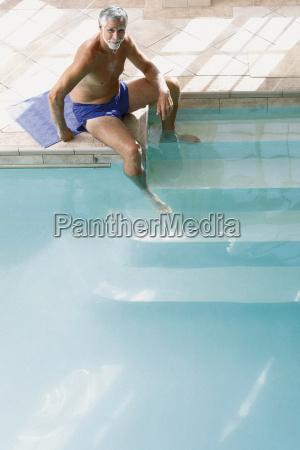 man on the edge of swimming