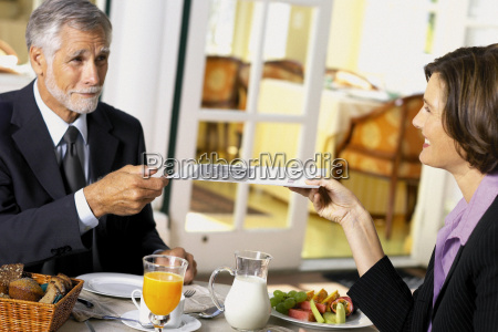 businessman and businesswoman conducting business over