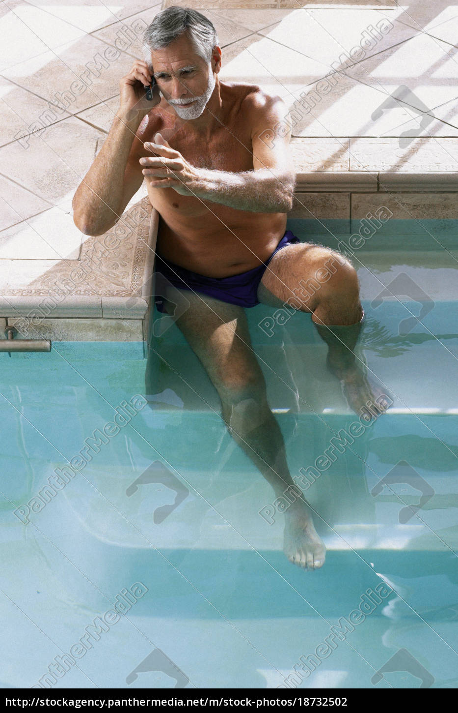 man, in, swimming, pool, with, cellphone - 18732502