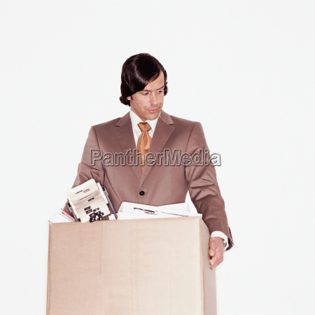 businessman carrying a box of papers