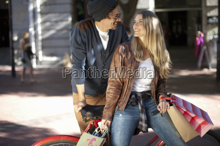 smiling young woman and boyfriend leaning