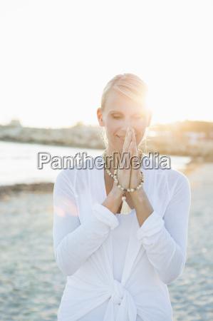woman in yoga prayer pose on