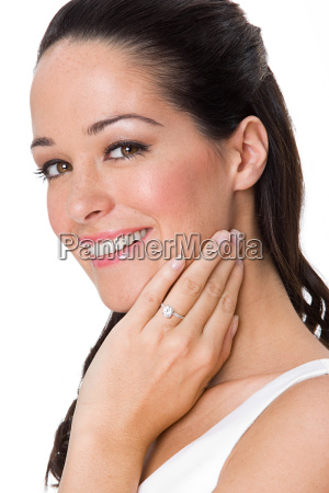 smiling woman wearing an engagement ring