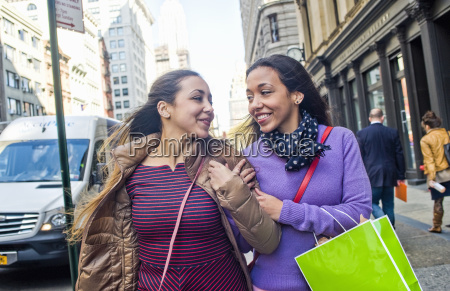 young female adult twins with shopping
