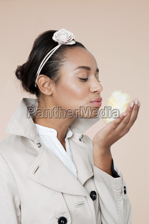 young woman blowing kiss to easter