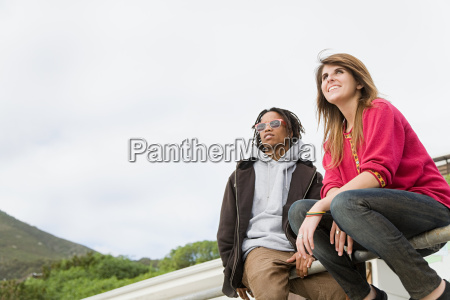 young couple looking away