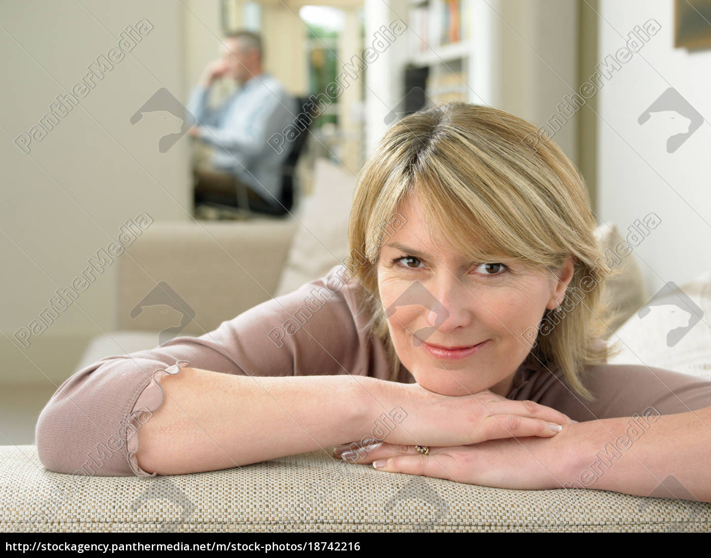 smiling, woman, resting, on, sofa - 18742216