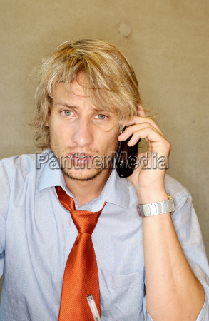 office worker using cellular telephone